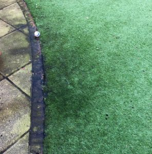 Black patches on artificial grass